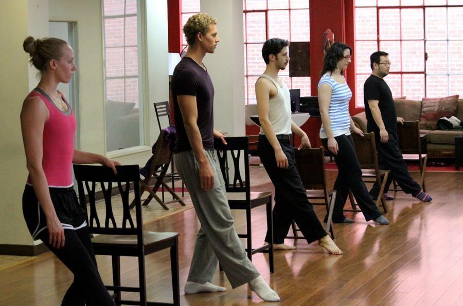 Dancers practice their technique in Ballet class